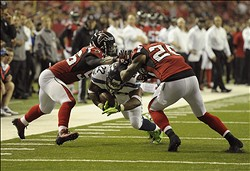 Jan 13, 2013; Atlanta, GA, USA; Seattle Seahawks running back Robert Turbin (22) runs as Atlanta Falcons outside linebacker Sean Weatherspoon (56) and strong safety William Moore (25) collide during the fourth quarter of the NFC divisional playoff game at the Georgia Dome. Mandatory Credit: Dale Zanine-USA TODAY Sports