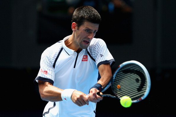 MELBOURNE, AUSTRALIA - JANUARY 18:  Novak Djokovic of Serbia plays a backhand in his third round match against Radek Stepanek of the Czech Republic during day five of the 2013 Australian Open at Melbourne Park on January 18, 2013 in Melbourne, Australia.  (Photo by Ryan Pierse/Getty Images)