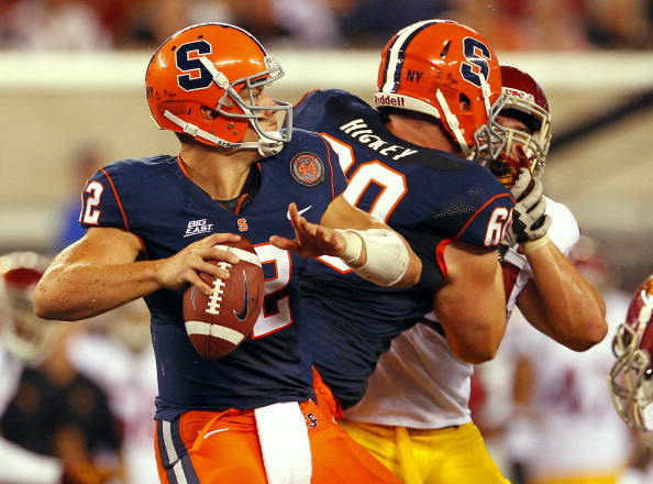 EAST RUTHERFORD, NJ - SEPTEMBER 08: Quarterback Ryan Nassib #12 of the Syracuse Orange looks to pass against the USC Trojans during a game at MetLife Stadium on September 8, 2012 in East Rutherford, New Jersey. (Photo by Rich Schultz/Getty Images)