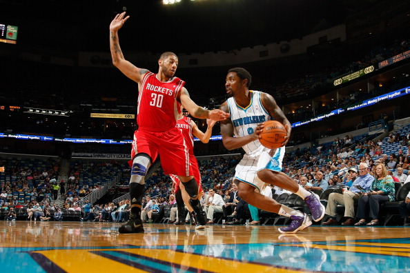 NEW ORLEANS, LA - OCTOBER 24:  Roger Mason Jr. #8 of the New Orleans Hornets drives the ball around Royce White #30 of the Houston Rockets at New Orleans Arena on October 24, 2012 in New Orleans, Louisiana.  NOTE TO USER: User expressly acknowledges and agrees that, by downloading and or using this photograph, User is consenting to the terms and conditions of the Getty Images License Agreement.  (Photo by Chris Graythen/Getty Images)