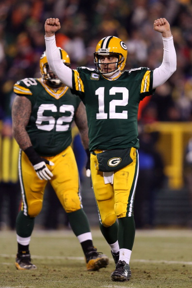 GREEN BAY, WI - JANUARY 05:  Quarterback Aaron Rodgers #12 of the Green Bay Packers celebrates after fullback John Kuhn #30 scores on a three-yard touchdown run in the second quarter against the Minnesota Vikings during the NFC Wild Card Playoff game at Lambeau Field on January 5, 2013 in Green Bay, Wisconsin.  (Photo by Andy Lyons/Getty Images)