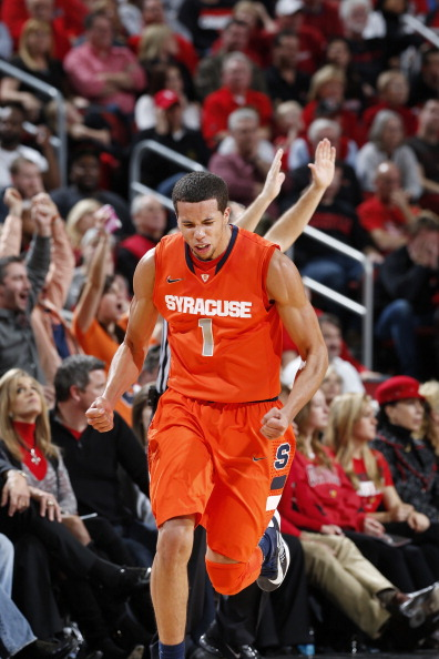 LOUISVILLE, KY - JANUARY 19: Michael Carter-Williams #1 of the Syracuse Orange reacts after hitting a three-point shot against the Louisville Cardinals during the game at KFC Yum! Center on January 19, 2013 in Louisville, Kentucky. Syracuse defeated Louisville 70-68. (Photo by Joe Robbins/Getty Images)