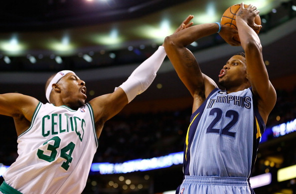 BOSTON, MA - JANUARY 2:  Rudy Gay #22 of the Memphis Grizzlies takes a shot over Paul Pierce #34 of the Boston Celtics during the game on January 2, 2013 at TD Garden in Boston, Massachusetts. NOTE TO USER: User expressly acknowledges and agrees that, by downloading and or using this photograph, User is consenting to the terms and conditions of the Getty Images License Agreement. (Photo by Jared Wickerham/Getty Images)