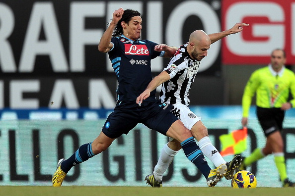 SIENA, ITALY - DECEMBER 22: Francesco Valiani of AC Siena fights for the ball with Edinson Cavani of SSC Napoli during the Serie A match between AC Siena and SSC Napoli at Stadio Artemio Franchi on December 22, 2012 in Siena, Italy.  (Photo by Gabriele Maltinti/Getty Images)