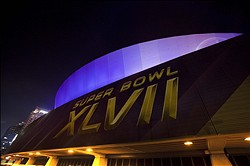 Jan 21, 2013; New Orleans, LA, USA; A general view of the exterior of the Mercedes-Benz Superdome in preparation for Super Bowl XLVII to be played between the San Francisco 49ers and the Baltimore Ravens on February 3, 2013. Mandatory Credit: Tyler Kaufman-USA TODAY Sports