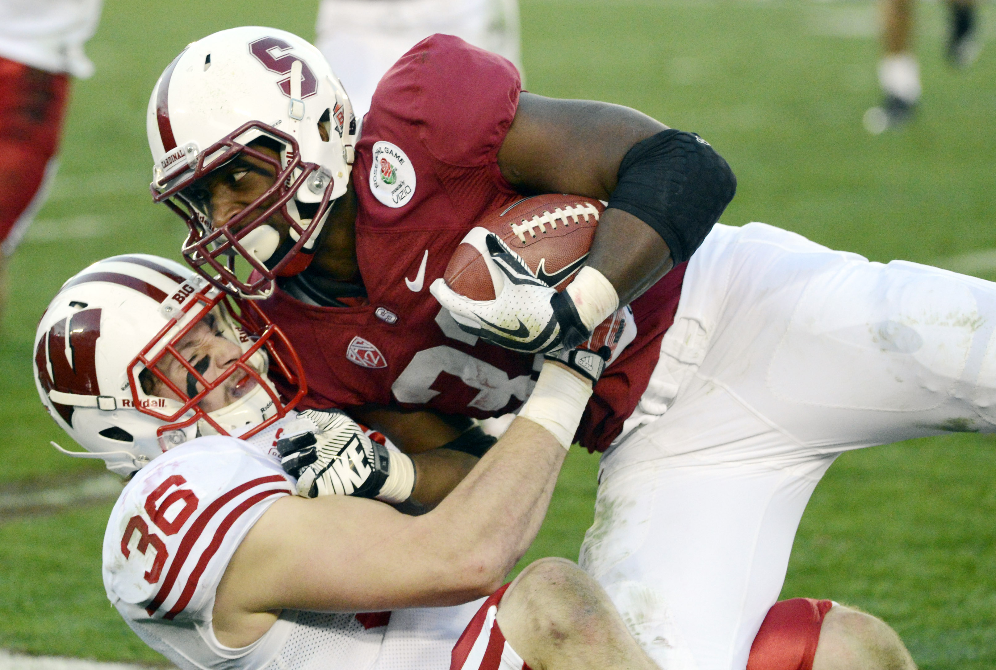 Jan 1, 2013; Pasadena, CA, USA; Stanford Cardinal running back Stepfan Taylor (33) celebrates the 20-14 victory against the Wisconsin Badgers during the 2013 Rose Bowl.  Mandatory Credit: Gary A. Vasquez-USA TODAY Sports
