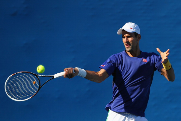 MELBOURNE, AUSTRALIA - JANUARY 23:  Novak Djokovic of Serbia plays a forehand in a practice session during day ten of the 2013 Australian Open at Melbourne Park on January 23, 2013 in Melbourne, Australia.  (Photo by Lucas Dawson/Getty Images)
