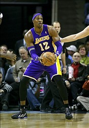 Jan 23, 2013; Memphis, TN, USA;  Los Angeles Lakers center Dwight Howard (12) reacts during the game against the Memphis Grizzlies at the FedEx Forum.  The Memphis Grizzlies defeated the Los Angeles Lakers 106-93.  Mandatory Credit: Spruce Derden–USA TODAY Sports
