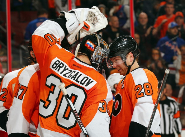 PHILADELPHIA, PA - JANUARY 24:  Claude Giroux #28 of the Philadelphia Flyers congratulates Ilya Bryzgalov #30 on the win after the game against the New York Rangers on January 24, 2013 at the Wells Fargo Center in Philadelphia, Pennsylvania. The Philadelphia Flyers defeated the New York Rangers 2-1.  (Photo by Elsa/Getty Images)