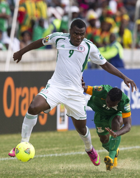 NELSPRUIT, SOUTH AFRICA - JANUARY 25:   Emmanuel Chinenye Emenike of Nigeria in action against Emmanuel Mbola from Zambia during the 2013 African Cup of Nations match between Zambia and Nigeria from Mbombela Stadium on January 25, 2013 in Nelspruit, South Africa.  (Photo by Manus van Dyk/Gallo Images/Getty Images)