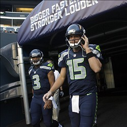 Aug 11, 2012; Seattle, WA, USA; NFL: Seattle Seahawks quarterbacks Matt Flynn (15) and Russell Wilson (3) walk on to the field for pregame warmups against the Tennessee Titans at CenturyLink Field. Mandatory Credit: Joe Nicholson-USA TODAY Sports