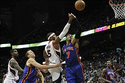 Apr 22, 2012; Atlanta, GA, USA; Atlanta Hawks power forward Josh Smith (5) and New York Knicks small forward Carmelo Anthony (7) fight for a rebound during the first half at Philips Arena. Mandatory Credit: Paul Abell-USA TODAY Sports