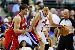 January 4, 2013; Auburn Hills, MI, USA; Detroit Pistons small forward Tayshaun Prince (22) is defended by Atlanta Hawks shooting guard Kyle Korver (26) at The Palace. Mandatory Credit: Rick Osentoski-USA TODAY Sports
