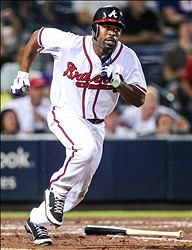 July 3, 2012; Atlanta, GA, USA; Atlanta Braves center fielder Michael Bourn (24) runs to first after hitting a three RBI triple in the fifth inning against the Chicago Cubs at Turner Field. Mandatory Credit: Daniel Shirey-USA TODAY Sports