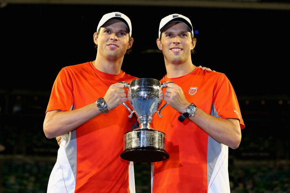 MELBOURNE, AUSTRALIA - JANUARY 26:  Bob Bryan of the United States and Mike Bryan of the United States celebrate with the championship trophy after winning their doubles final match against Robin Haase of the Netherlands and Igor Sijsling of the Netherlands during day thirteen of the 2013 Australian Open at Melbourne Park on January 26, 2013 in Melbourne, Australia.  (Photo by Michael Dodge/Getty Images)