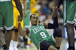 Jan 22, 2013; Cleveland, OH, USA; Boston Celtics point guard Rajon Rondo (9) is helped to his feet in the third quarter against the Cleveland Cavaliers at Quicken Loans Arena. Mandatory Credit: David Richard-USA TODAY Sports