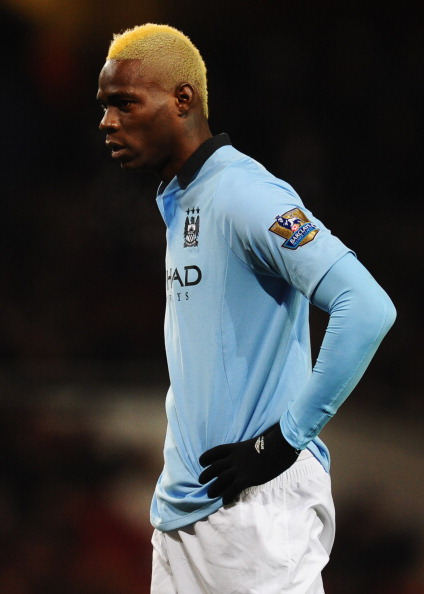 LONDON, ENGLAND - JANUARY 13:  Mario Balotelli of Manchester City looks on during the Barclays Premier League match between Arsenal and Manchester City at Emirates Stadium on January 13, 2013 in London, England.  (Photo by Mike Hewitt/Getty Images)