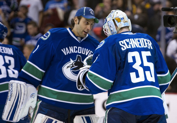 VANCOUVER, CANADA - NOVEMBER 29: Goalie Roberto Luongo #1 of the Vancouver Canucks congratulates goalie Cory Schneider #35 after defeating the Columbus Blue Jackets in NHL action on November 29, 2011 at Rogers Arena in Vancouver, British Columbia, Canada.  (Photo by Rich Lam/Getty Images)