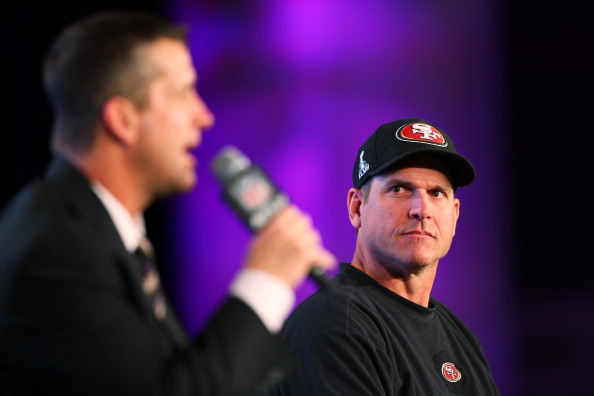 NEW ORLEANS, LA - FEBRUARY 01:  Head coach John Harbaugh (L) of the Baltimore Ravens and Head coach Jim Harbaugh of the San Francisco 49ers speak to the media during a press conference at the Ernest N. Morial Convention Center on February 1, 2013 in New Orleans, Louisiana. The Ravens will play the 49ers in Super Bowl XLVII on Sunday.  (Photo by Mike Ehrmann/Getty Images)