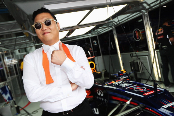 YEONGAM-GUN, SOUTH KOREA - OCTOBER 14:  Korean rapper Psy visits the Red Bull Racing garage before the Korean Formula One Grand Prix at the Korea International Circuit on October 14, 2012 in Yeongam-gun, South Korea.  (Photo by Mark Thompson/Getty Images)