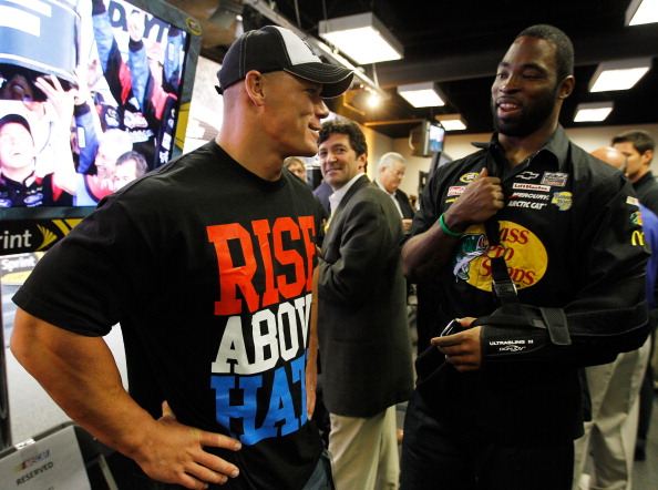 DAYTONA BEACH, FL - FEBRUARY 26:  Professional wrestler John Cena (L) talks with Justin Tuck (R) #91 of the New York Giants in the drivers meeting prior to the start of the NASCAR Sprint Cup Series Daytona 500 at Daytona International Speedway on February 26, 2012 in Daytona Beach, Florida.  (Photo by Chris Graythen/Getty Images)