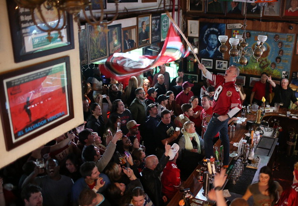 SAN FRANCISCO, CA - FEBRUARY 03:  A San Francisco 49er fan waves a flag on the bar at Ireland's 32 during a Super Bowl XLVII watch party on February 3, 2013 in San Francisco, California. The San Francisco 49ers are facing off against the Baltimore Ravens in Super Bowl XLVII at the Superdome in New Orleans, Louisana.  (Photo by Justin Sullivan/Getty Images)