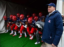 Dec. 15, 2012; Albuquerque, NM, USA; Arizona Wildcats head coach Rich Rodriguez (right) waits with his team prior to entering the field before the game against the Nevada Wolf Pack in the 2012 New Mexico Bowl at University Stadium. Arizona defeated Nevada 49-48. Mandatory Credit: Mark J. Rebilas-USA TODAY Sports