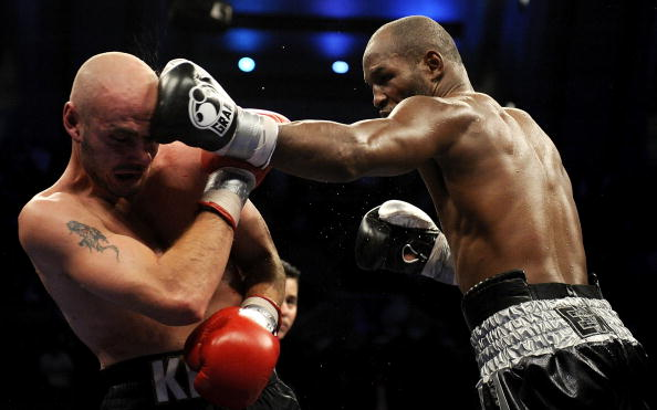 ATLANTIC CITY, NJ - OCTOBER 18:  Bernard Hopkins of Philadelphia,  Pennsylvania (R) connects with a jab to Kelly Pavlik of Youngstown, Ohio during their light heavyweight bout at Boardwalk Hall on October 18, 2008 in Atlantic City, New Jersey.  (Photo by Jeff Zelevansky/Getty Images)