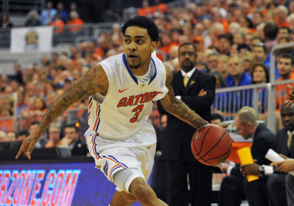 GAINESVILLE, FL - JANUARY 19:  Guard Mike Rosario #3 of the Florida Gators drives up court against the Missouri Tigers January 19, 2013 at Stephen C. O'Connell Center in Gainesville, Florida. The Gators won 83 - 52. (Photo by Al Messerschmidt/Getty Images)