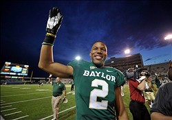 Nov 3, 2012; Waco, TX, USA; Baylor Bears wide receiver Terrance Williams (2) celebrates a win over the Kansas Jayhawks at Floyd Casey Stadium. The Bears defeated the Jayhawks, 41-14. Mandatory Credit: Jerome Miron-USA TODAY Sports