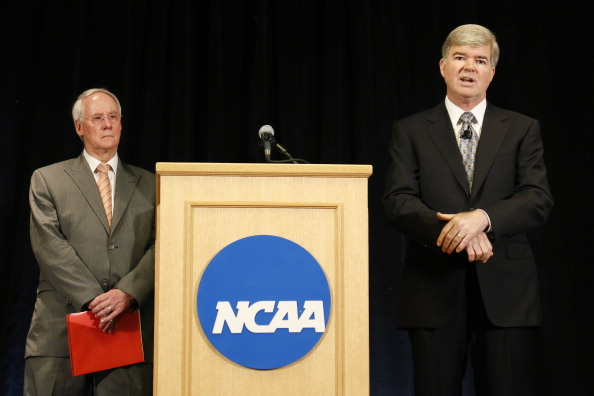 INDIANAPOLIS, IN - JULY 23: NCAA president Mark Emmert (R) speaks as Ed Ray, chairman of the NCAA's executive committee and Oregon State president looks on, during a press conference at the NCAA's headquarters to announce sanctions against Penn State University's football program on July 23, 2012 in Indianapolis, Indiana. The sanctions are a result of a report that the university concealed allegations of child sexual abuse made against former defensive coordinator Jerry Sandusky, who was found guilty on 45 of 48 counts related to sexual abuse of boys over a 15-year period. (Photo by Joe Robbins/Getty Images)
