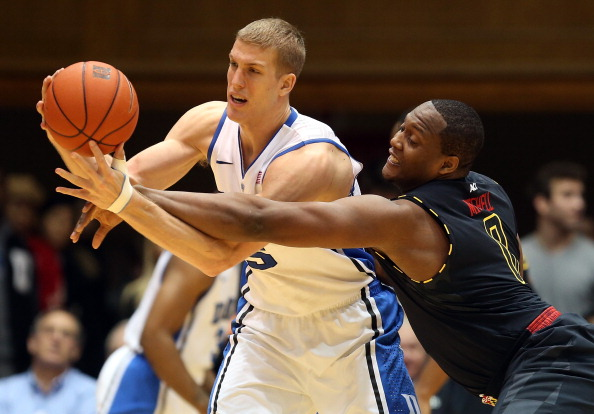 DURHAM, NC - JANUARY 26:  Charles Mitchell #0 of the Maryland Terrapins goes after Mason Plumlee #5 of the Duke Blue Devils during their game at Cameron Indoor Stadium on January 26, 2013 in Durham, North Carolina.  (Photo by Streeter Lecka/Getty Images)