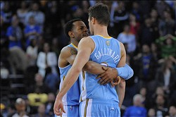November 10, 2012; Oakland, CA, USA; Denver Nuggets shooting guard Andre Iguodala (9) congratulates small forward Danilo Gallinari (8) after Gallinari made a three-point basket during the second overtime against the Golden State Warriors at ORACLE Arena. The Nuggets defeated the Warriors 107-101 in double overtime. Mandatory Credit: Kyle Terada-USA TODAY Sports