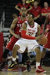 Jan 16, 2013; College Park, MD, USA; Maryland Terrapins guard Dez Wells (32) backs in against North Carolina State Wolfpack guard Lorenzo Brown (2) at the Comcast Center. Mandatory Credit: Mitch Stringer-USA TODAY Sports