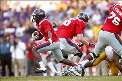 November 17, 2012; Baton Rouge, LA, USA; Ole Miss Rebels running back Jeff Scott (3) carries the ball against the LSU Tigers during the first half at Tiger Stadium. LSU defeated Ole Miss 41-35. Mandatory Credit: Crystal LoGiudice-USA TODAY Sports