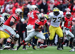 Nov 24, 2012; Columbus, OH, USA; Ohio State Buckeyes running back Carlos Hyde (34) runs the ball in the second quarter against the Michigan Wolverines at Ohio Stadium. Mandatory Credit: Andrew Weber-USA TODAY Sports