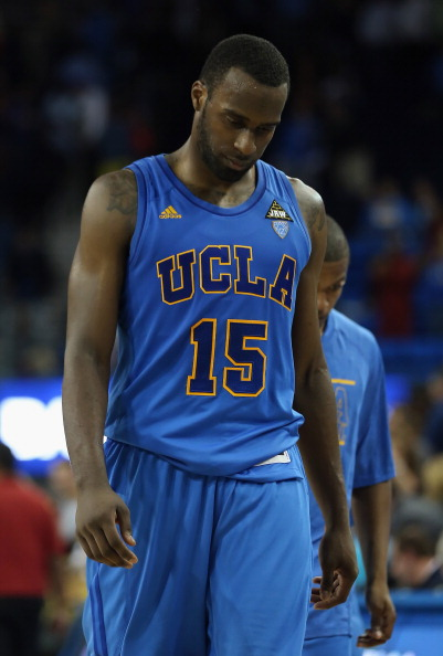LOS ANGELES, CA - JANUARY 30:  Shabazz Muhammad #15 of the UCLA Bruins hangs his head as he walks off the court following the Bruins' 75-71 overtime defeat to the USC Trojans at Pauley Pavilion on January 30, 2013 in Los Angeles, California.  (Photo by Jeff Gross/Getty Images)
