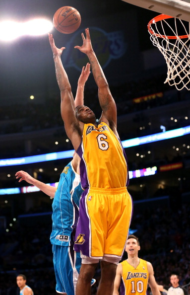 LOS ANGELES, CA - JANUARY 29:  Earl Clark #6 of the Los Angeles Lakers grabs a rebound against the New Orleans Hornets at Staples Center on January 29, 2013 in Los Angeles, California. . The Lakers won 111-106.  NOTE TO USER: User expressly acknowledges and agrees that, by downloading and or using this photograph, User is consenting to the terms and conditions of the Getty Images License Agreement.  (Photo by Stephen Dunn/Getty Images)