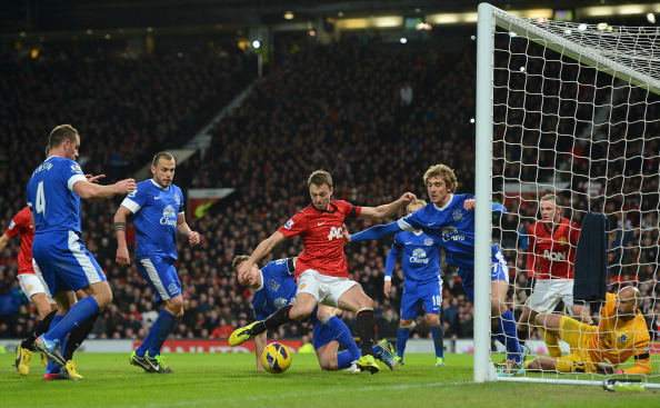 MANCHESTER, ENGLAND - FEBRUARY 10:  Jonny Evans of Manchester United shoots at goal under pressure during the Barclays Premier League match between Manchester United and Everton at Old Trafford on February 10, 2013 in Manchester, England. (Photo by Shaun Botterill/Getty Images)