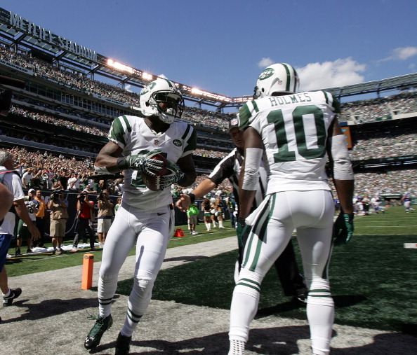 EAST RUTHERFORD, NJ - SEPTEMBER 9: Jeremy Kerley #11 of the New York Jets celebrates his touchdown catch with teammate Santonio Holmes #10 against the Buffalo Bills during their season opener at MetLife Stadium on September 9, 2012 in East Rutherford, New Jersey. (Photo by Rich Schultz /Getty Images)