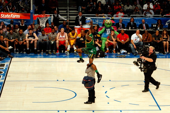 ORLANDO, FL - FEBRUARY 25:  Jeremy Evans of the Utah Jazz jumps over comedian Kevin Hart as he wears a Karl Malone Utah Jazz throwback jersey on a dunk during the Sprite Slam Dunk Contest part of 2012 NBA All-Star Weekend at Amway Center on February 25, 2012 in Orlando, Florida.  NOTE TO USER: User expressly acknowledges and agrees that, by downloading and or using this photograph, User is consenting to the terms and conditions of the Getty Images License Agreement.  (Photo by Mike Ehrmann/Getty Images)