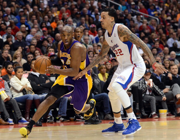 LOS ANGELES, CA - JANUARY 04:  Kobe Bryant #24 of the Los Angeles Lakers drives past Matt Barnes #22 of the Los Angeles Clippers during a 107-102 Clipper win at Staples Center on January 4, 2013 in Los Angeles, California.  NOTE TO USER: User expressly acknowledges and agrees that, by downloading and or using this photograph, User is consenting to the terms and conditions of the Getty Images License Agreement.  (Photo by Harry How/Getty Images)