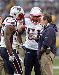 October 30, 2011; Pittsburgh,PA, USA: New England Patriots head coach Bill Belichik (right) talks to defenders Brandon Spikes (55) and Jerod Mayo (51) during a time-out against the Pittsburgh Steelers during the first quarter at Heinz Field. The Steelers won 25-17. Mandatory Credit: Charles LeClaire-USPRESSWIRE