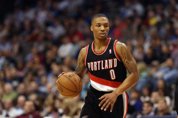 DALLAS, TX - FEBRUARY 06:  Damian Lillard #0 of the Portland Trail Blazers at American Airlines Center on February 6, 2013 in Dallas, Texas.  NOTE TO USER: User expressly acknowledges and agrees that, by downloading and or using this photograph, User is consenting to the terms and conditions of the Getty Images License Agreement.  (Photo by Ronald Martinez/Getty Images)