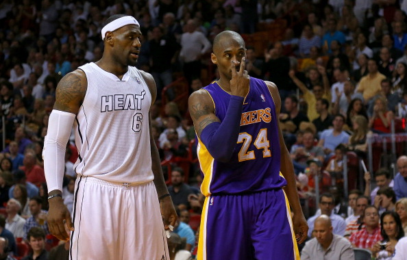 MIAMI, FL - FEBRUARY 10:  Kobe Bryant #24 of the Los Angeles Lakers and LeBron James #6 of the Miami Heat plead with a referee during a game  at American Airlines Arena on February 10, 2013 in Miami, Florida.  (Photo by Mike Ehrmann/Getty Images)