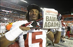 Jan 7, 2013; Miami, FL, USA; Alabama Crimson Tide wide receiver Eddie Williams (15) holds up a newspaper after the 2013 BCS Championship game against the Notre Dame Fighting Irish at Sun Life Stadium. Alabama won 42-14.  Mandatory Credit: John David Mercer-USA TODAY Sports