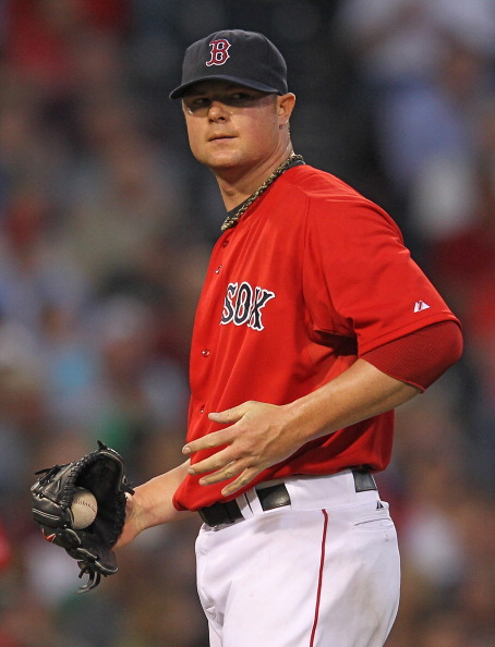 BOSTON, MA - MAY 25:  Jon Lester #31 of the Boston Red Sox reacts in the third inning against the Tampa Bay Rays at Fenway Park May 25, 2012  in Boston, Massachusetts. (Photo by Jim Rogash/Getty Images)