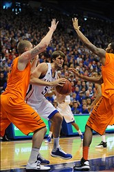February 02, 2013; Lawrence, KS, USA; Kansas Jayhawks center Jeff Withey (5) tries to pass as Oklahoma State Cowboys center Philip Jurick (44) and forward Michael Cobbins (20) defend in the first half at Allen Fieldhouse. Oklahmoa State won 85-80. Mandatory Credit: Denny Medley-USA TODAY Sports