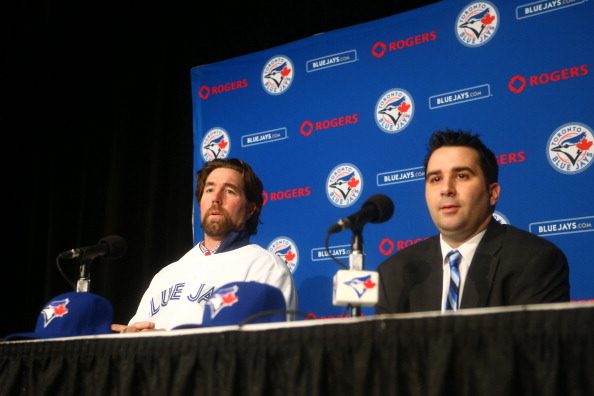 TORONTO, CANADA - JANUARY 08: R.A. Dickey #43 of the Toronto Blue Jays is introduced at a press conference by general manager Alex Anthopoulos at Rogers Centre on January 8, 2013 in Toronto, Ontario, Canada. (Photo by Tom Szczerbowski/Getty Images)