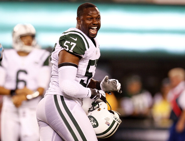 EAST RUTHERFORD, NJ - AUGUST 26:   Bart Scott #57 of the New York Jets reacts during a preseason game against the Carolina Panthers at MetLife Stadium on August 26, 2012 in East Rutherford, New Jersey.  (Photo by Jeff Zelevansky/Getty Images)